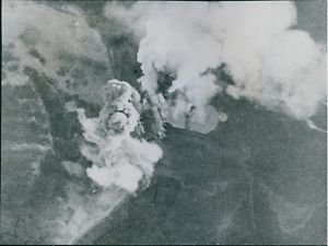 Dramatic end of the Tirpitz: capsizes after attack by bomber.Smoke from the bomb