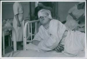 A wounded woman lying in the bed hospital after the war in Poland, 1939. - 8x10