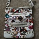 White With Multi Colored Design The Sak Cross Body Bag