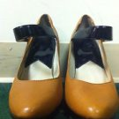 Woman's Michael Kors size 8m tan/ black Mary Jane heels