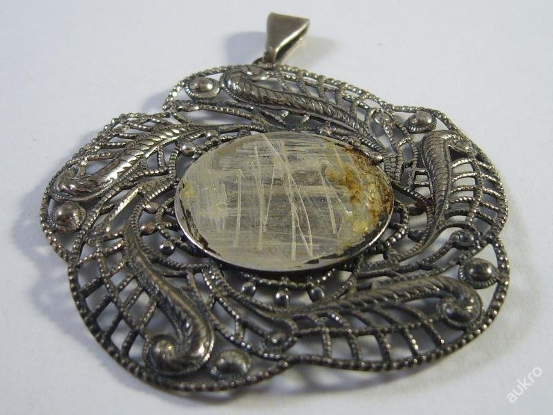 Old silver pendant for a photo