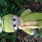 Baby in frog suit
