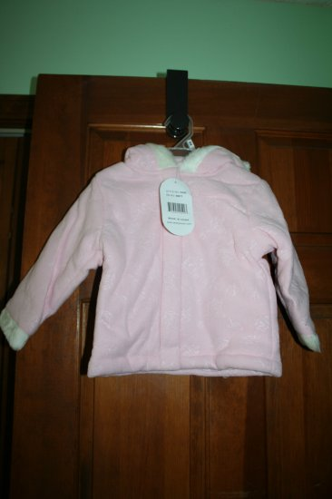 Pink colored winter hooded coat.