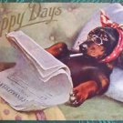 Dachshund Dog n Bed Reads Newspaper Smokes Cigarette-Happy Days-Antique Postcard