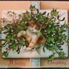 Kitten Holly Bursting thru Envelope Ribbons-Vintage A Happy Christmas Postcard