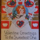 YOUNG GIRL HOLDS LACE HEART- VINTAGE EMBOSSED VALENTINE WHITNEY POSTCARD