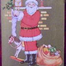 Santa Claus Red Suit Stands Stuffing Christmas Stocking-Antique Vintage Postcard