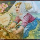 DUTCH GIRL HAT BASKET SAILING SHIPS ANTIQUE VINTAGE EMBOSSED VALENTINE POSTCARD