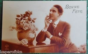 DAPPER MAN SMOKES CIGARETTE DREAMS-VINTAGE ART DECO PARIS RPPC PHOTO POSTCARD