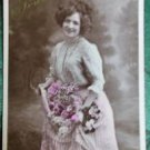 YOUNG LADY APRON FULL of FLOWERS-HAND TINTED-ANTIQUE RPPC PHOTO POSTCARD-PARIS