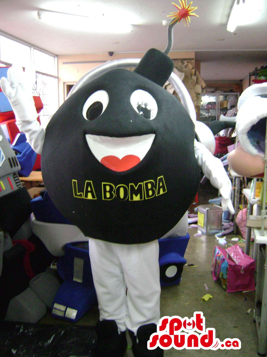Black Bomb Mascot SpotSound Canada With Letters And Peculiar Face