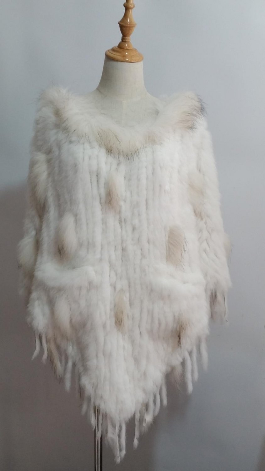 White crochet rabbit fur cape with raccoon fur tri
