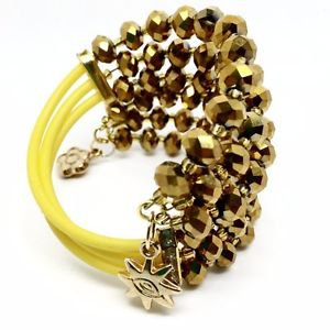 SIX LAYERS BRACELET WITH STONES. Yellow, Golden, Clear