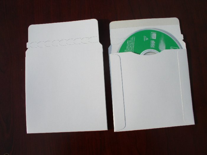 100 CARDBOARD CD/DVD MAILER W/SEAL, SEAM & FLAP - JS93