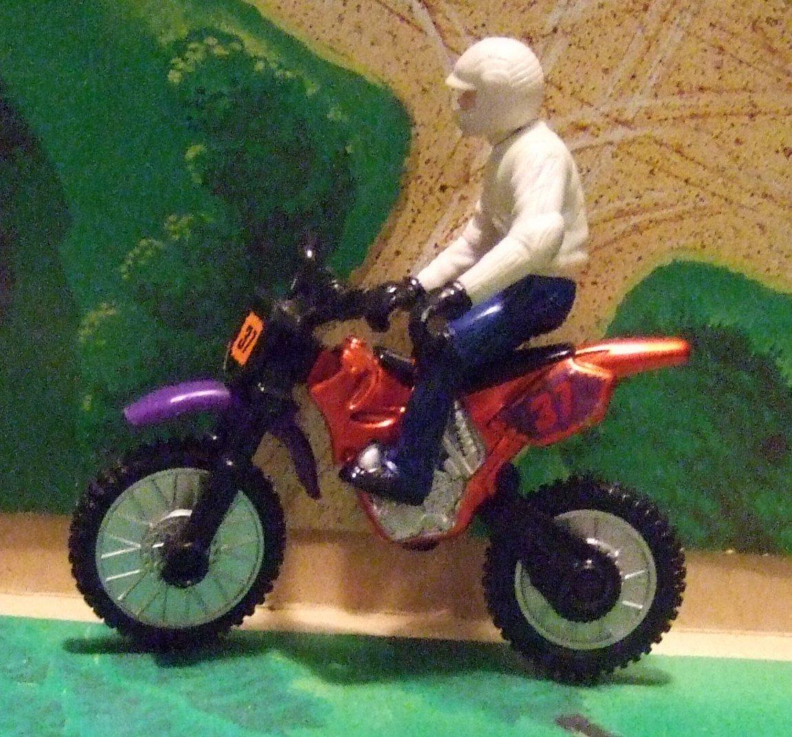Guy On Motocycle Toy