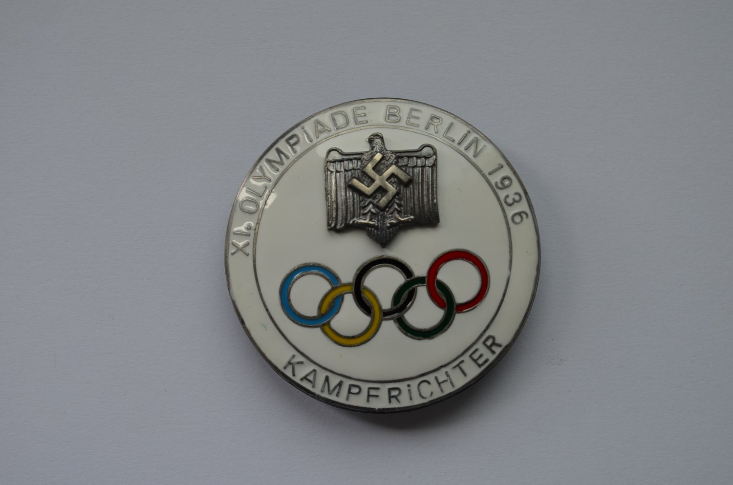 WWII THE GERMAN BADGE XI OLYMPIADE BERLIN 1936 KAMPFRICHTER WHITE