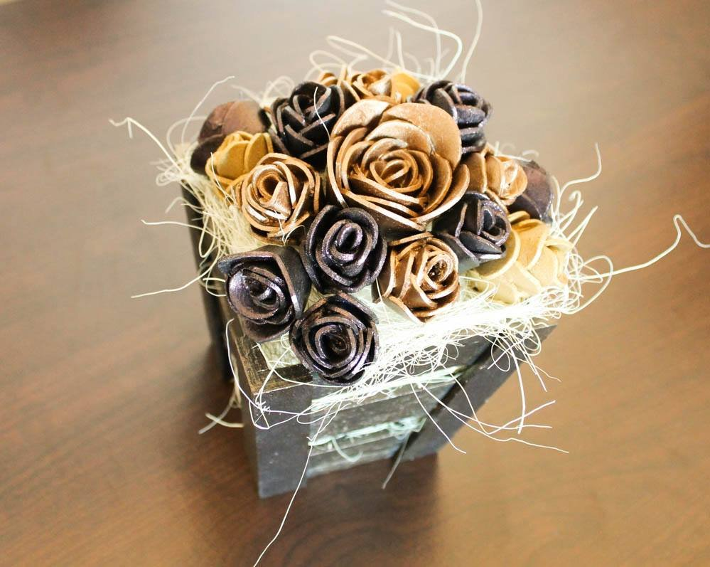 Golden roses in box