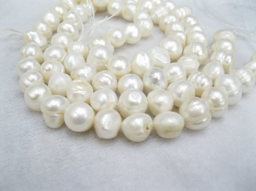 10-11mm freshwater ringed  genuine pearl on  loose strand,01005XC