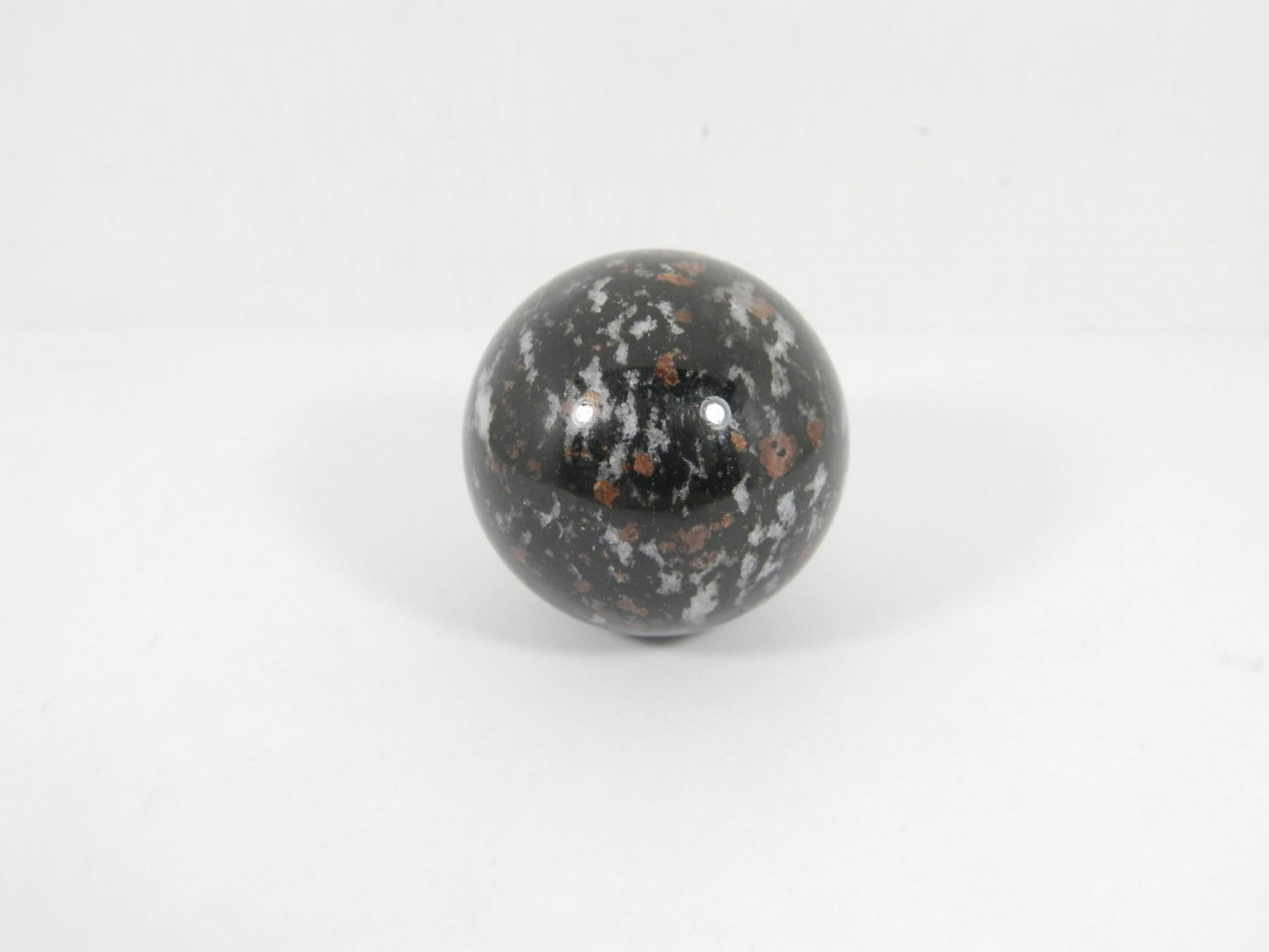 Garnet in Feldspar stone sphere (37 mm.) from Russia