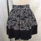 BALENCIAGA. SILK BLACK/ WHITE PINTUCKED W/ TIE AROUND MINI SKIRT SIZE 38