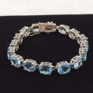 SKY BLUE TOPAZ CUT OVALS (16) SET IN STERLING SILVER 925 TENNIS BRACELET 8""