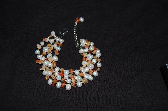 4 strand pearl w/ orange stone Bracelet B1120
