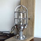 Driftwood and polished metal nautical table light bulkhead cage light