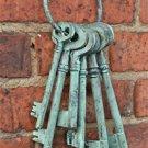 BEAUTIFUL SET OF LARGE CAST IRON ANTIQUE STYLE KEYS ON KEY RING VERDIGRIS FINISH