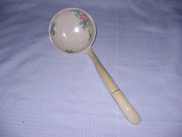 Vintage ceramic soup ladle