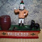 Trick dog cast iron mechanical coin bank clown jumping dog antique reproduction