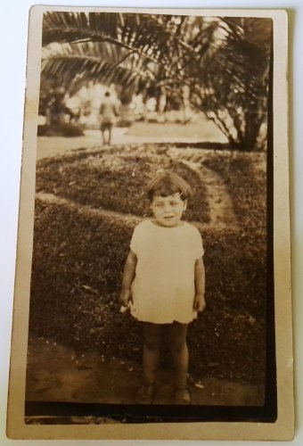 Old photo postcard portrait of a girl in the park