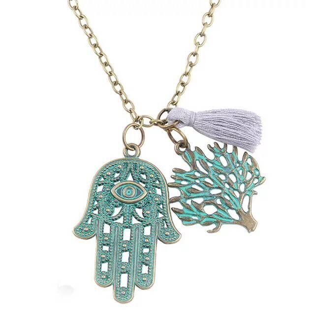 The ancient bronze Life Tree Pendant Necklace has a couple