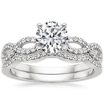 1.50 Tcw Round Cut Solitaire CZ Infinity Style Bridal Ring Set in 10k White Gold