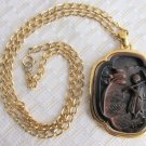1970s Vintage Crown TRIFARI Asian Walking Geisha Brown Carved Pendant Necklace Gold Plate Chain