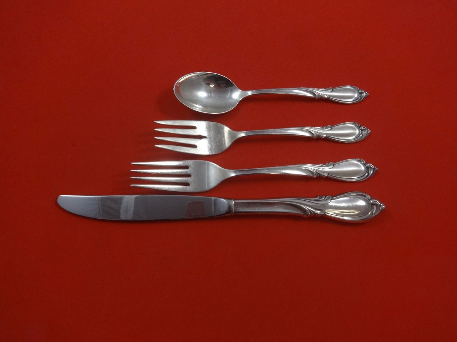 Rhapsody New by International Sterling Silver Regular Size Place Setting(s) 4pc