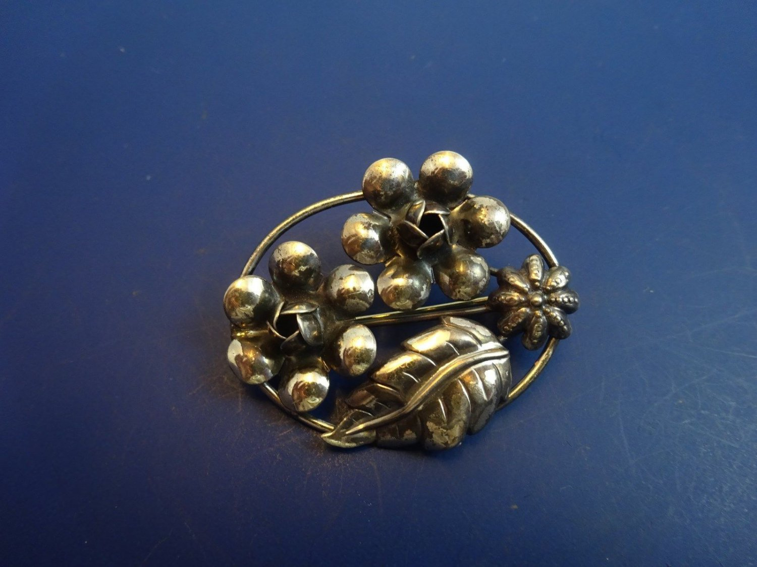 Sterling Silver Pin with Floral Design in Oval Shape by Lang (1125)