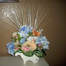 Pastel-Floral-Arrangement-Centerpiece-Glass-wheel-barrel