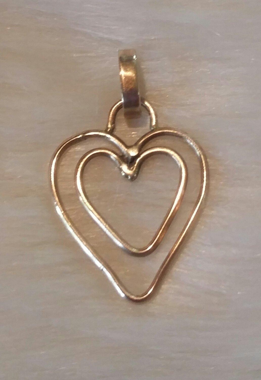 "10 kt. Gold double heart pendant 1 1/4"" long"