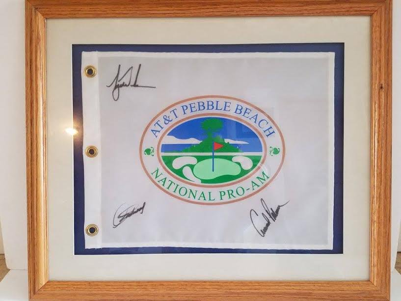 PEBBLE BEACH GOLF FLAG SIGNED BY ARNOLD PALMER, TIGER WOODS, AND CLINT EASTWOOD