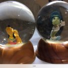 Jimmyoty cricket and pluto snow globes. Limited edition
