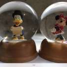 Minnie and Doanld snow globes