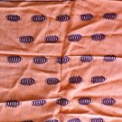 Peachy Orange Table Runner with Purple Decoration