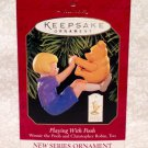 """HALLMARK KEEPSAKE ORNAMENT """" PLAYING WITH POOH"""" 1ST IN SERIES 1999"""