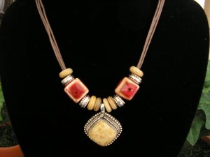 Brown Cord with clay beads and bone pendant.