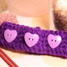 Purple crochet bracelet with light purple heart buttons