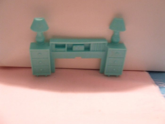 Dollhouse Furniture Molded turquoise plastic headboard  marked Superior
