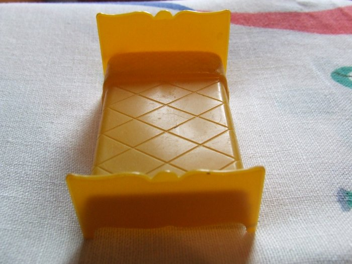 Dollhouse Furniture Molded Gold Plastic bed marked MARX $3.00 shipping included