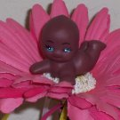 Baby Girl on pink flower pens - african american