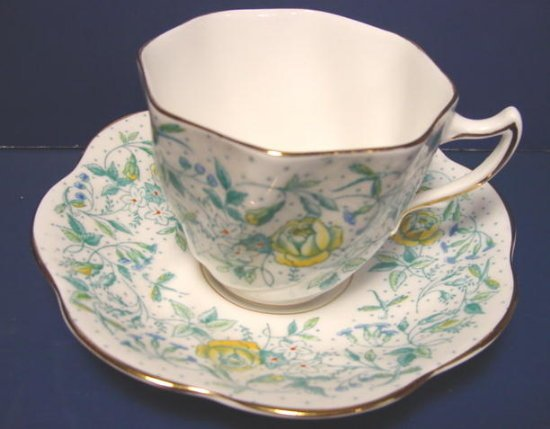 Rosina bone china cup and saucer England green yellow flowers porcelain ruffled gold trim edge
