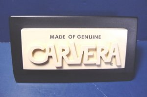 Vintage Made of Genuine Carvera advertising store shelf sign, ivory color black heavy paperweight